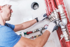 professional Springfield, VA Plumbing Services fixing a pipe
