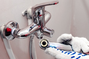 faucet being installed by Centreville, VA Plumbing Services
