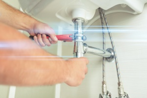 sink being repaired by Falls Church, VA Plumbing Services