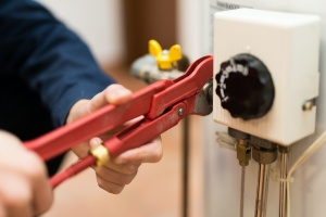 close up of someone trying to do a Water Heater Repair