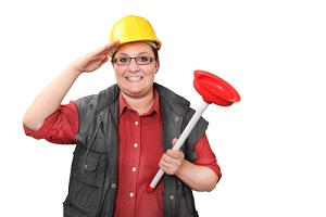 female master plumber with red toilet plunger saluted