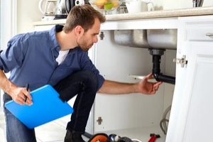 plumber checking the sink
