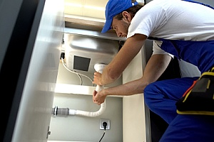 a plumber unclogging a home plumbing vent