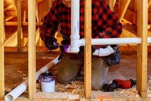 plumber pipe drain and vent plumbing system at new home construction